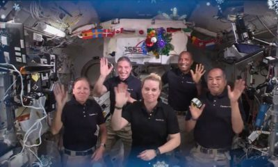 Astronauts on the International Space Space Station beam Christmas cheer to Earth